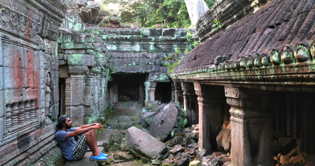 a man sitting in temple ruins